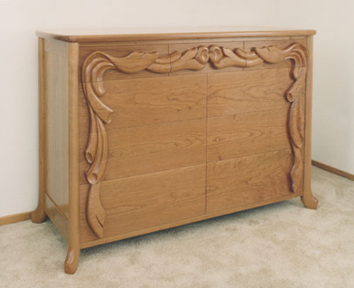 Carved cherry dresser